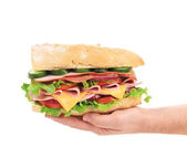 French baguette sandwich in hand. — Stock Photo