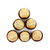 Triangle of golden bonbons. — Stock Photo