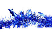 Christmas blue tinsel with stars. — Stock Photo