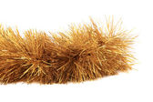 Close up of christmas golden tinsel. — Stock Photo
