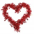 Christmas red tinsel with stars as heart — Stock Photo