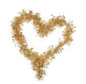 Heart from Christmas golden tinsel — Stock Photo