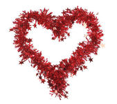 Christmas red tinsel with stars as heart — Stok fotoğraf