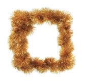 Christmas golden tinsel as frame — Stock Photo