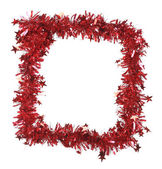 Christmas red tinsel as frame — Photo