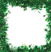 Green tinsel with stars — Photo