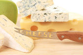 Cheeses on wood — Stock Photo