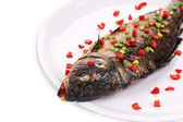 Fried fish with paprika. — Stock Photo
