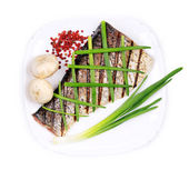Grilled carp fillet on plate with onion. — Stok fotoğraf