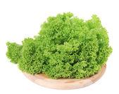 Fresh lettuce on wooden platter. — Stock Photo