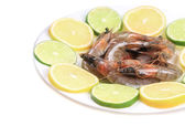 Raw shrimps on plate. — Stock Photo