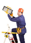 Worker on ladder with hammer — Stock Photo