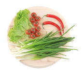 Vegetables and herbs on platter. — Stock Photo