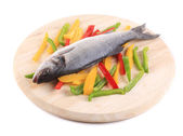 Raw seabass with pepper slices. — Stock Photo