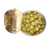 Tin can with green peas. — Stock Photo