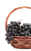 Grapes in a wicker basket. — Stock Photo