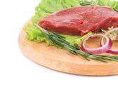 Raw beef steak on platter. — Stock Photo
