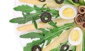Salad with anchovies and asparagus. — Stock Photo