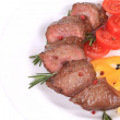 Beefsteaks with tomatoes and rosemary. — Stock Photo #45643567