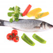 Fresh seabass fish with pepper. — Stock Photo