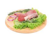 Raw beefsteak on platter. — Stock Photo