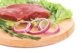 Raw beefsteak on platter. — Stockfoto