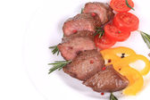 Beefsteaks with tomatoes and rosemary. — Stock Photo