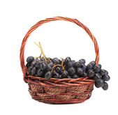 Red grapes in wicker basket. — Stock Photo