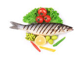 Grilled seabass with vegetables on plate. — Stock Photo