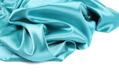 Soft folds and highlights of light blue silk. — Stock Photo