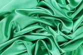 Soft folds and highlights of light green silk. — Stock Photo