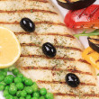 Grilled fish fillet with tasty vegetables. — Stock Photo
