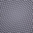 Hexagonal mesh on a grey background. — Stock Photo