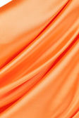 Orange silk background. — Stock Photo