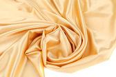 Gold silk swirl. — Stock Photo