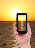 Taking sunset photo on smartphone. — Stock Photo