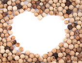 White peppercorn in shape of heart. — Stock Photo