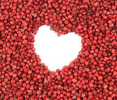 Red peppercorn in shape of heart. — Stock Photo