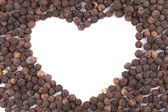 Black peppercorn in shape of heart. — Stock Photo