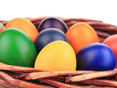 Colorful easter eggs in basket. — Stock Photo