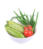Bowl with marrows and tomatoes. — Stock Photo