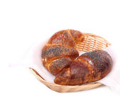 Croissants with poppy on wicker basket. — Foto Stock