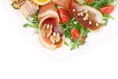 Salat mit rucola und schinken. — Stockfoto