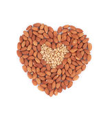 Almonds nuts in heart shape. — Foto de Stock