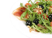 Salad with arugula and prosciutto. — Stock Photo
