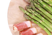Platter with asparagus and prosciutto. — Stock Photo