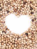 Heart in white pepper. — Stock Photo