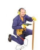 工人在耳罩与钻和局. — 图库照片