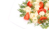 Cauliflower salad with tomatoes and dill. — Stock Photo