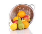 Metal colander full of juicy fruits. — Stock Photo